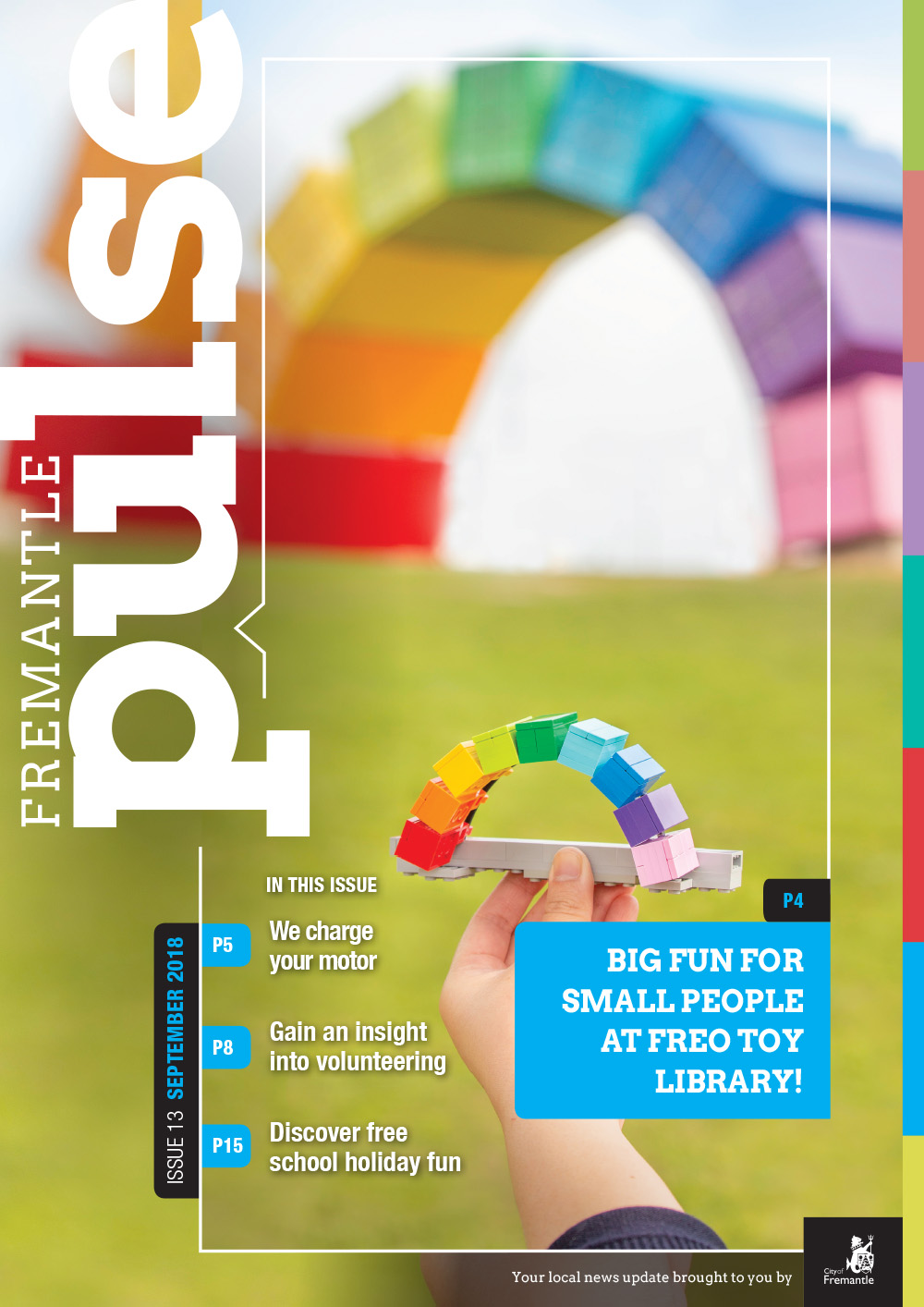 Front cover of the Pulse magazine showing a hand holding up a mini rainbow container with the real rainbow contain in the background.