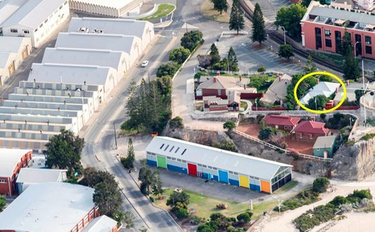 Birds eye shot of Arthur's Head with the Captain's Lane property circled in yellow.