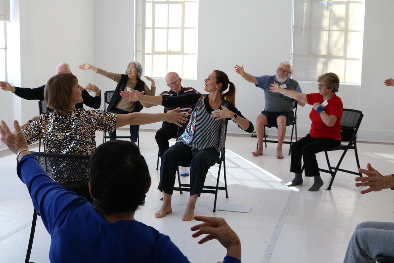 photo of instructor and dance participants with Parkinsons sitting in chairs at the West Australian Ballet centre in Maylands, Western Australia