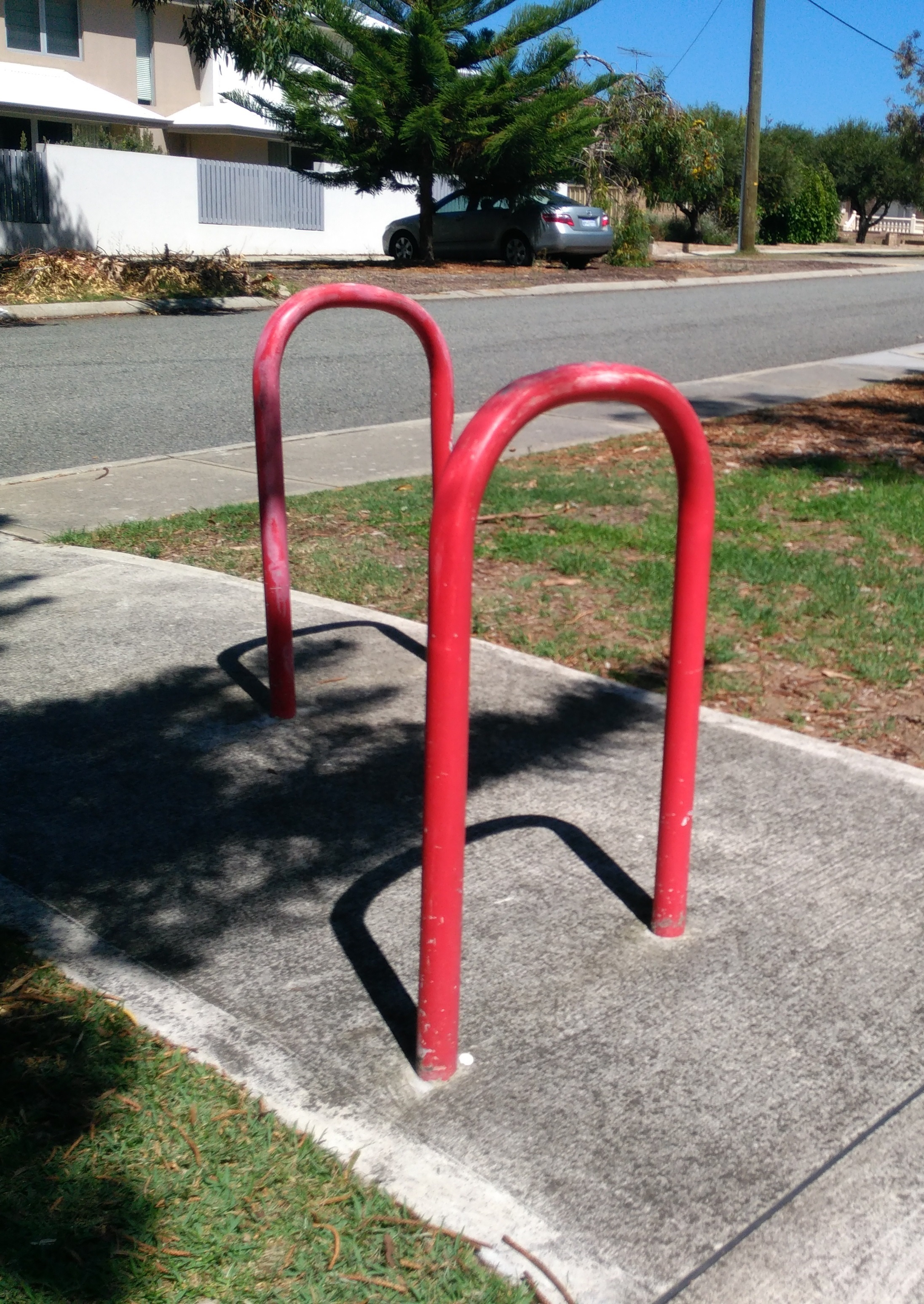 Red handles in a footpath.