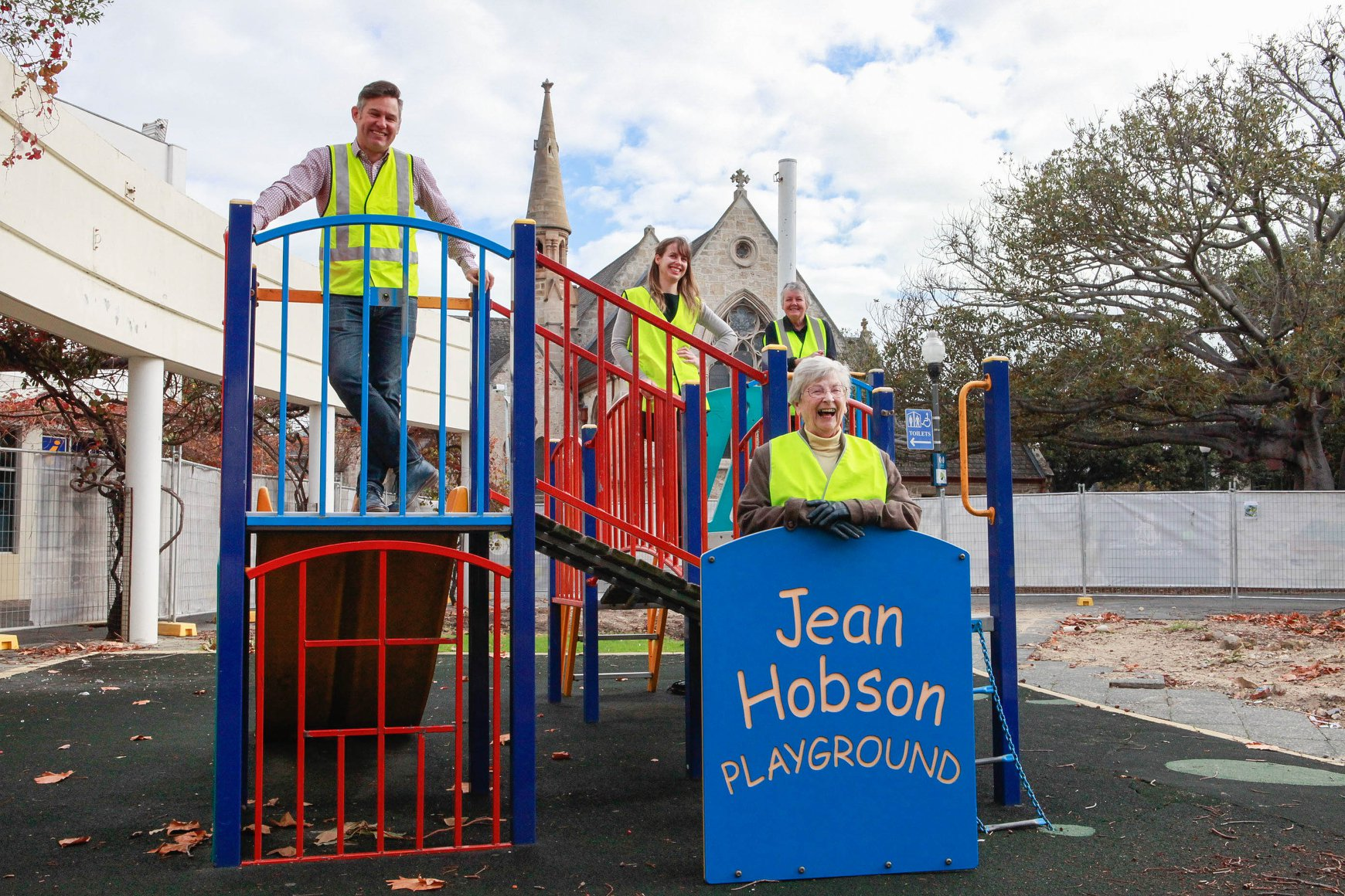 Jean Hobson with a few people standing on the playground