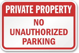 A private parking sign