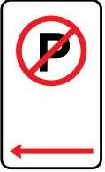 A parking sign showing a letter P with a red line through it.