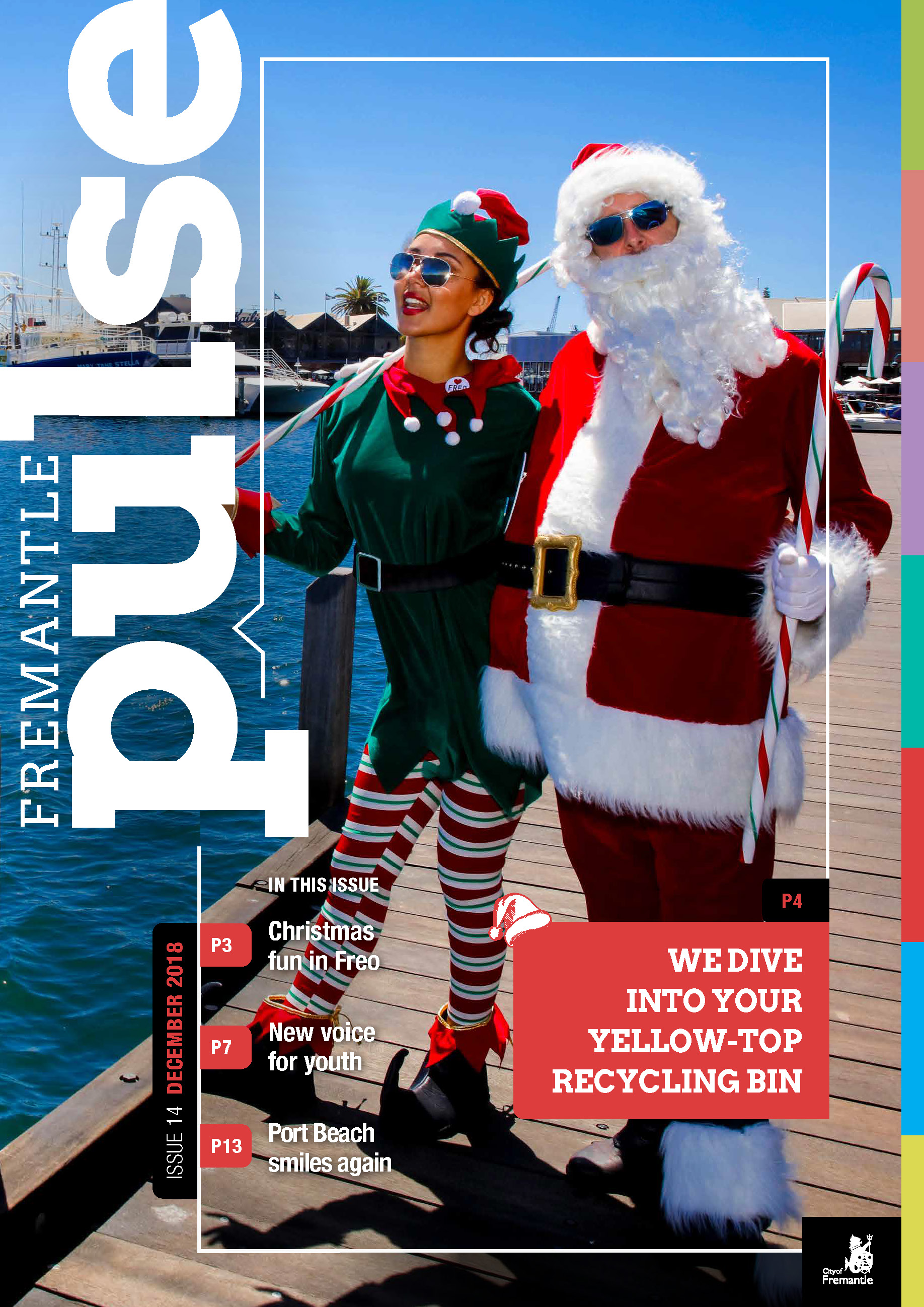 Santa and an Elf standing on the Fishing Boat Harbour boardwalk