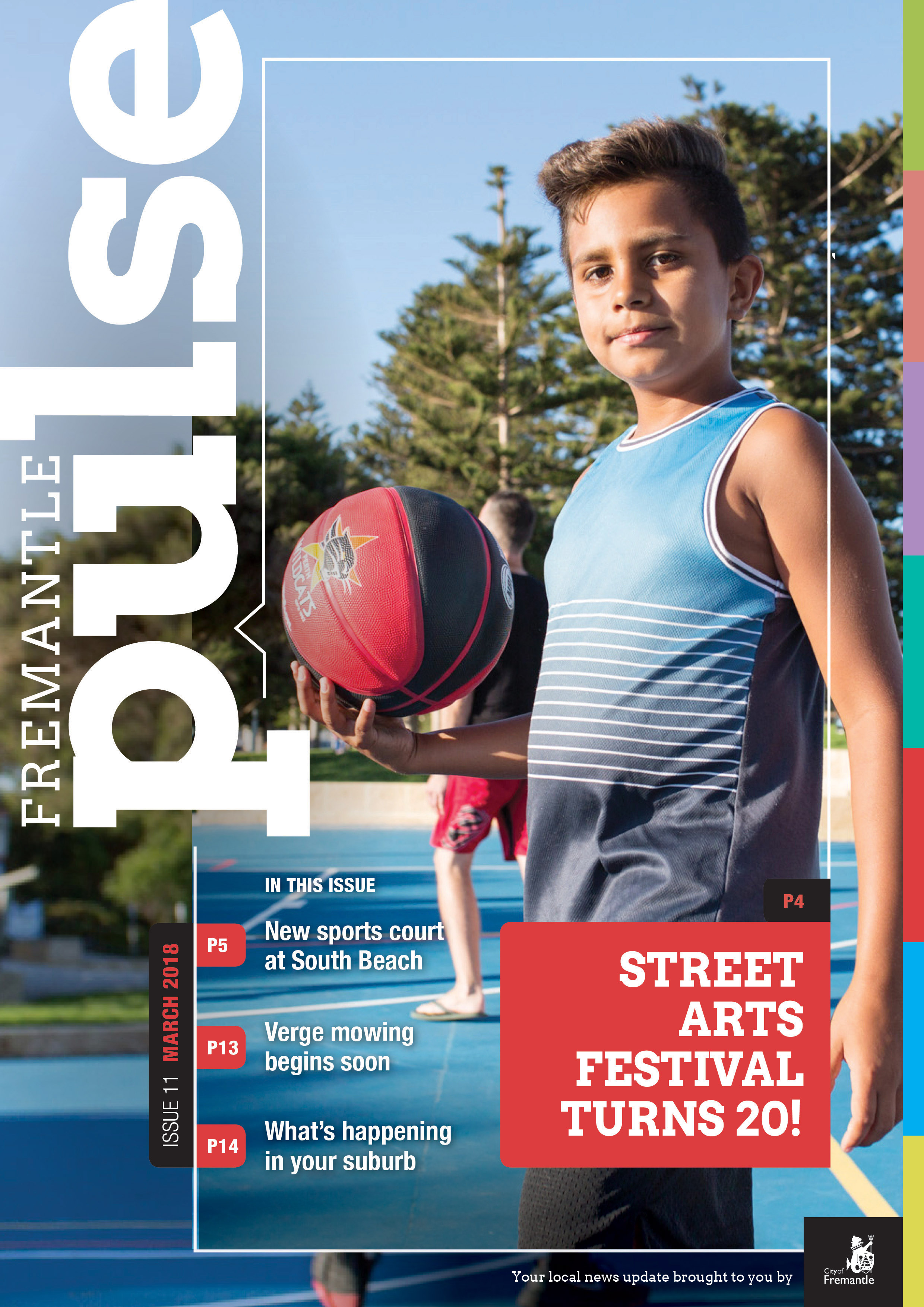 Front cover of the magazine featuring a young boy standing with a basketball on a basketball court.