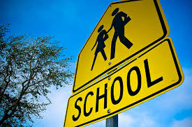 A yellow school crossing sign.