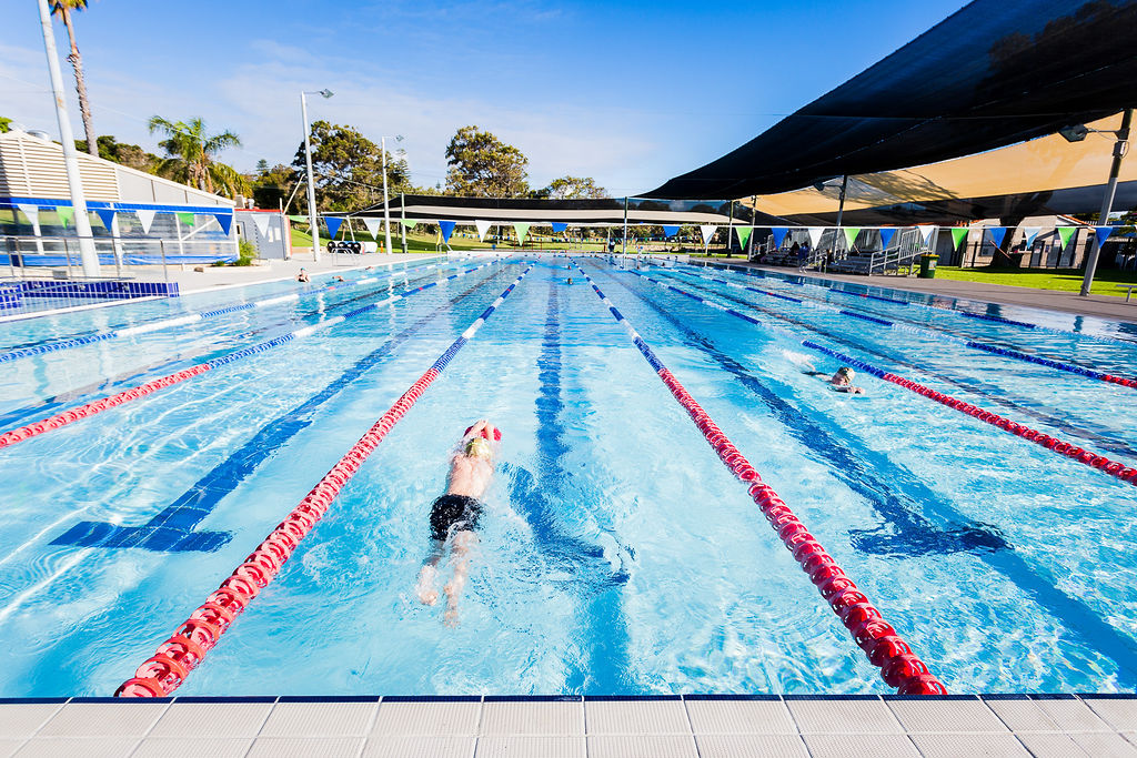 50 metre pool with swimmer