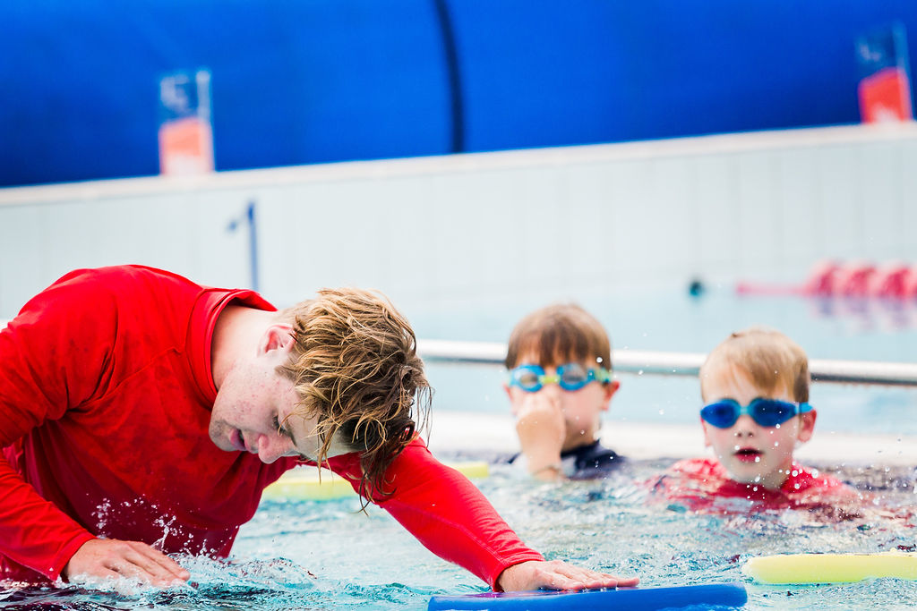 swim school teacher and children