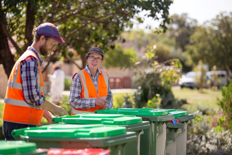 Officers inspecting bins