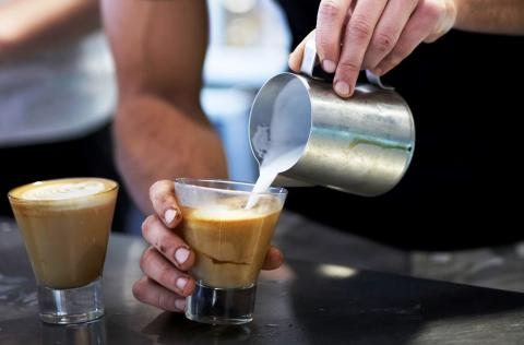Barista making a coffee with fair trade products