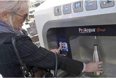 Visitor using the ProAcqua machine